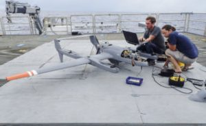 Scott Brown and Sophia Brumer, and engineer and PhD candidate from Columbia University respectively, retrieve data from hemispheric radiators integrated into a UAV as soon as it lands. SOI/ Mónika Naranjo González