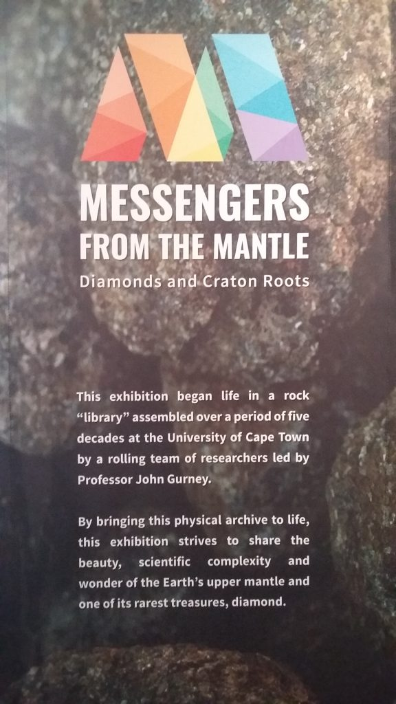 """Entrance sign for the """"Messengers from the Mantle"""" exhibit."""