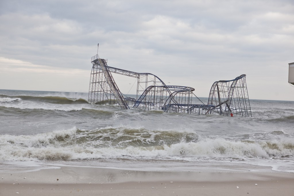 In 2012, Hurricane Sandy damaged or destroyed more than 650,000 U.S. homes and caused $50 billion in damage, including destroying this roller coaster in Seaside Heights, New Jersey. Rising sea levels likely mean hundreds of billions of dollars more costs this century from flooding and damage from coastal storms, says a new report by the Risky Business Project that uses data from a new study in Earth's Future, an AGU journal. Credit: Anthony Quinano/Flickr