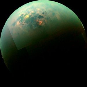 "This near-infrared, color mosaic from NASA's Cassini spacecraft shows the sun glinting off of Titan's north polar seas. A new study suggests a ""bucket brigade"" ""bucket brigade"" brings liquid to moon's north pole. Credit: NASA/JPL-Caltech/University of Arizona/University of Idaho"