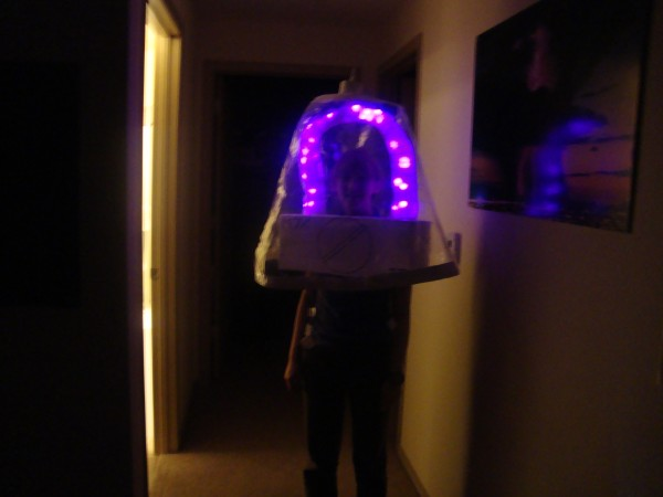 """This is Lindsey Richardson, M.S. Meteorology, who also enjoys electrical engineering. Her Vacuum Tube costume includes battery operated lights, a """"plastic"""" tube shell, and an """"exhaust"""" tip. Photo courtesy of Lindsey Richardson."""